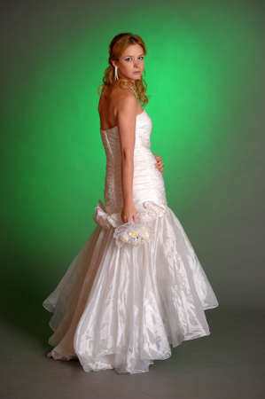 beautiful young woman in a wedding dress in the studio Stock Photo - 14293673