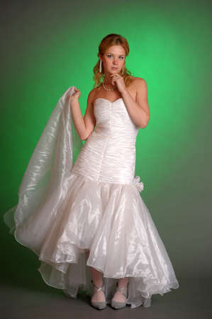 beautiful young woman in a wedding dress in the studio Stock Photo - 14293675