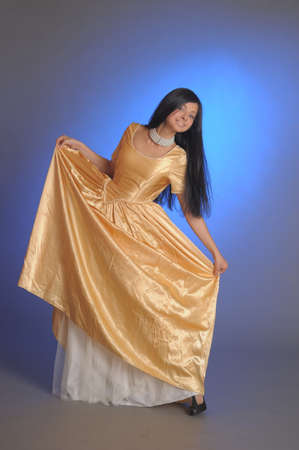 Elegant girl beauty posing in a golden dress Stock Photo - 14403212