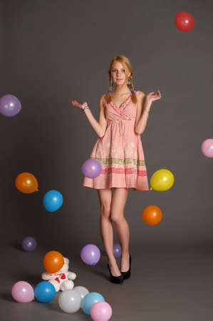 Girl With a studio with balloons Stock Photo - 14403490