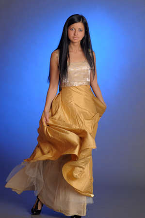Elegant girl beauty posing in a golden dress Stock Photo - 14403194
