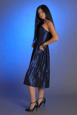 dark-haired girl in a blue dress Stock Photo - 18260852