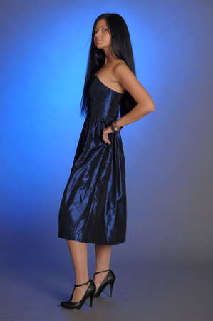 dark-haired girl in a blue dress