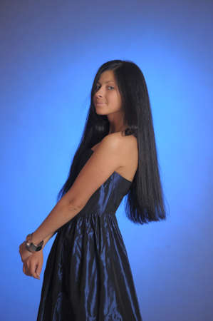 dark-haired girl in a blue dress Stock Photo - 18260941