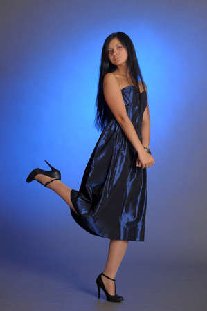 dark-haired girl in a blue dress photo