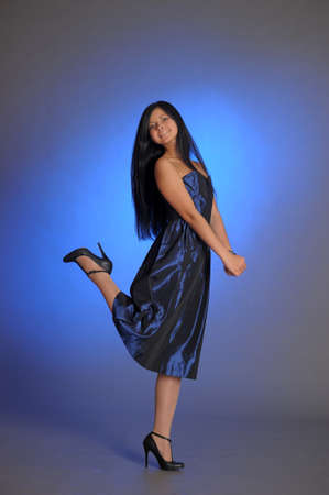 dark-haired girl in a blue dress Stock Photo - 18260917