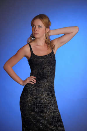 girl in a black evening dress in the Studio  photo
