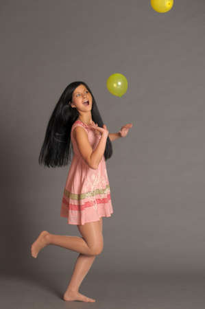 Girl With a studio with balloons Stock Photo