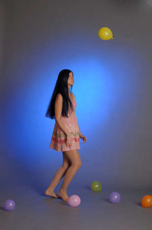 Girl With a studio with balloons photo