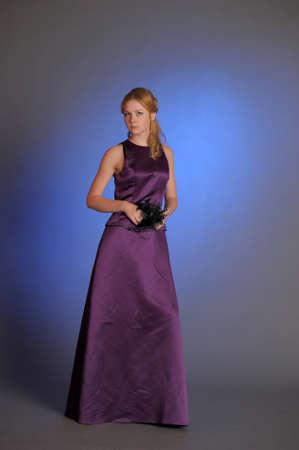 Stunning woman in purple dress  Stock Photo - 15109763