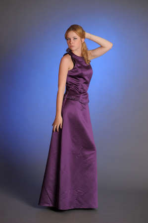 Stunning woman in purple dress Stock Photo - 15109765