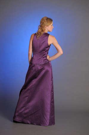 Stunning woman in purple dress  Stock Photo - 15109771