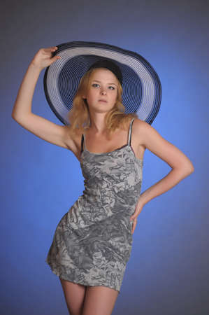 girl in a slinky short dress and wide-brimmed hat Stock Photo - 17909480