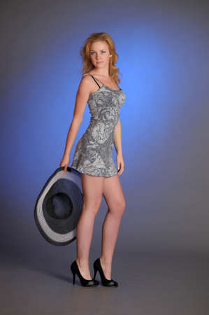 tight fitting: girl in a slinky short dress and wide-brimmed hat Stock Photo