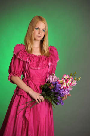girl in Victorian dress with a bouquet of flowers Stock Photo - 13929224