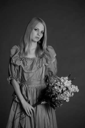 girl in Victorian dress with a bouquet of flowers Stock Photo - 13929216