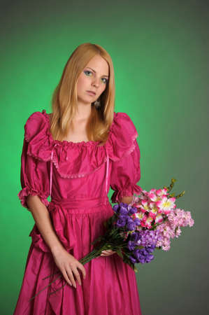 girl in Victorian dress with a bouquet of flowers Stock Photo - 13929221