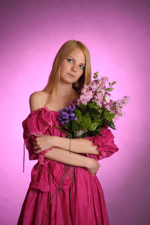 girl in Victorian dress with a bouquet of flowers photo