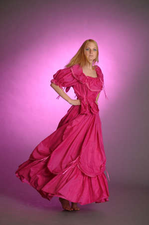 formalwear: the girl in an ancient pink dress Stock Photo