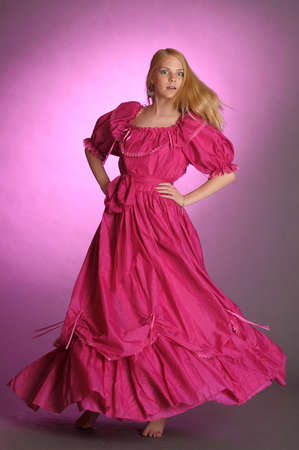 victorian lady: the girl in an ancient pink dress Stock Photo