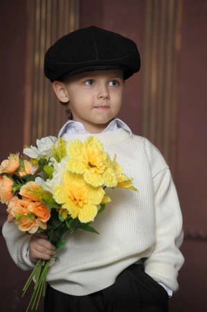 Little Boy with flowers Stock Photo - 14092803
