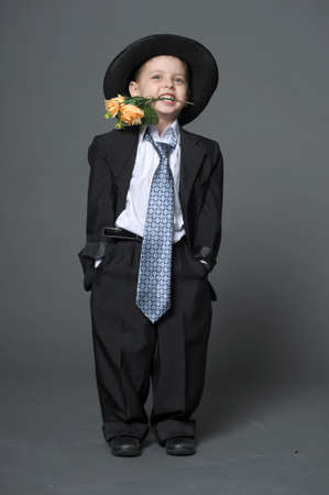 Boy in costume with flowers Stock Photo - 14049276