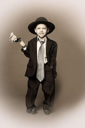 Boy in costume with flowers photo