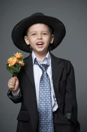Boy in costume with flowers