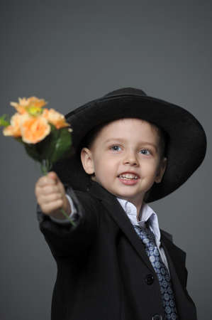 Boy in costume with flowers Stock Photo - 14049592