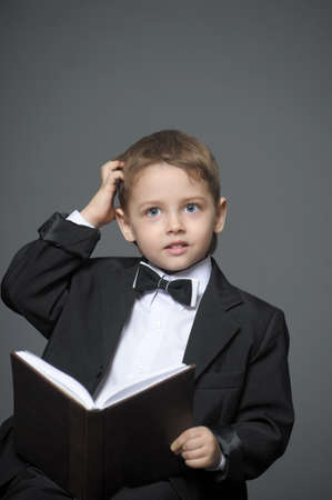 Boy in a suit with a book Stock Photo - 14049205