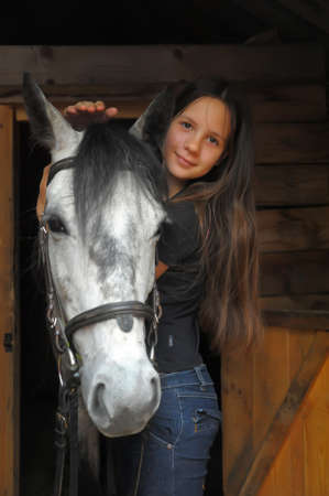 pony girl: Teen girl hugging a horse