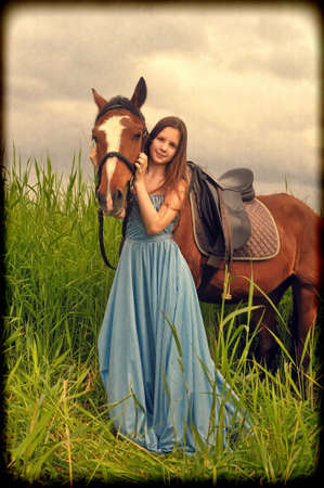 girl in long dress with a horse Stock Photo - 14106197