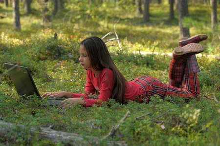 girl with laptop in the woods Stock Photo - 14106826