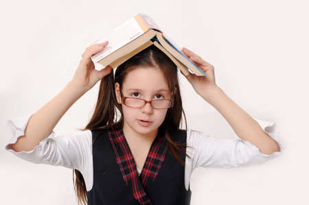 Adorable girl studying with a book on her head Stock Photo - 14106818