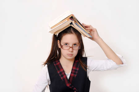 Adorable girl studying with a book on her head Stock Photo - 14106816