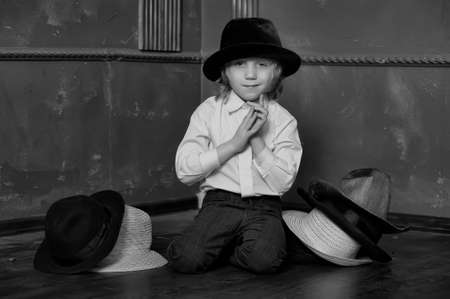 the boy measures at once many hats Stock Photo - 14106930