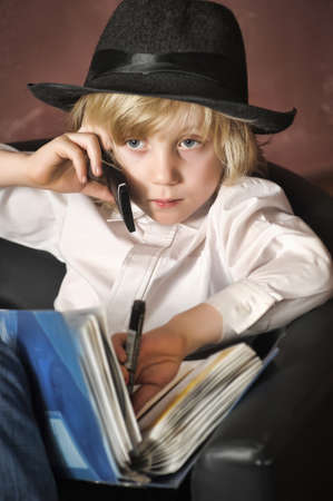 little boy in the role of a businessman photo