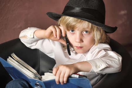 little boy in the role of a businessman Stock Photo - 14954192