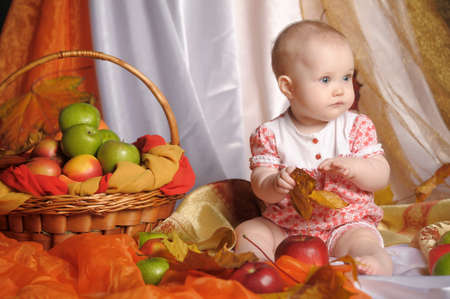 small child with  apples photo