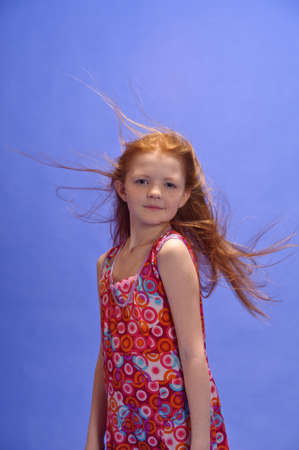 red-haired girl in studio photo