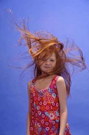 red-haired girl in studio Stock Photo