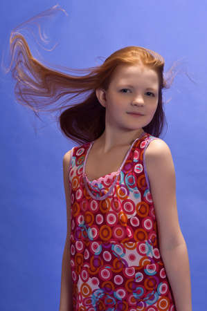 red-haired girl in studio Stock Photo - 14124082
