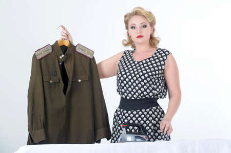 houseclean: the young girl irons a soldier s blouse