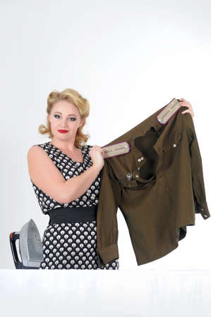 the young girl irons a soldier s blouse Stock Photo - 14167667