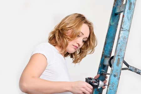 yourselfer: girl with a screwdriver Stock Photo