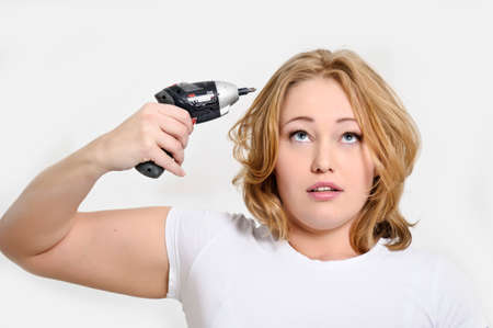 kidding: girl with a screwdriver Stock Photo
