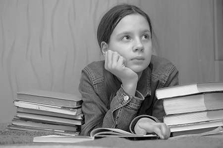 The girl the teenager is upset by the big homework Stock Photo - 14190815