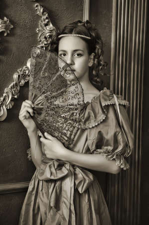 Portrait of the young Victorian girl, he photo is executed in vintage style photo