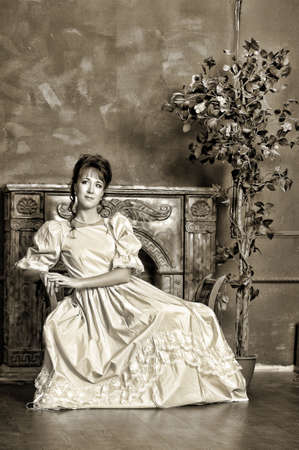dressups: The young woman in a ball dress, the photo is executed in vintage style