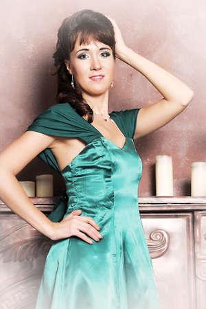 Elegant beautiful woman in fashion dress posing indoors photo